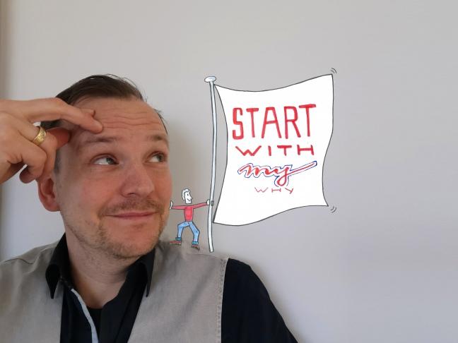 Foto von Jan der auf ein illustriertes Männlein auf seiner Schulter schielt, das eine Fahne mit der Aufschrift trägt: Start with my why.